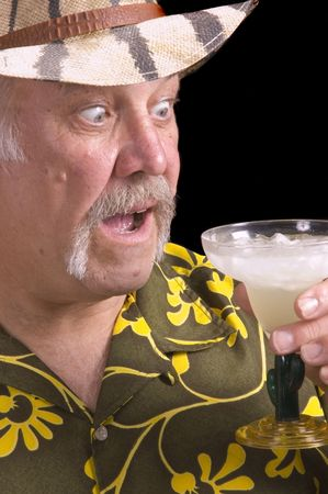 Man in floral shirt Hawaiian shirt, with a fu manchu mustache, safari hat and Margarita doing a Jimmy Buffet impersonation