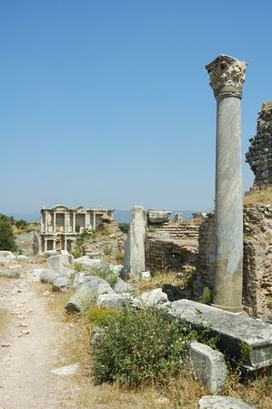 remains: Roman street in Ephesus, Turkey with columns and the library of Celsus at the end Stock Photo