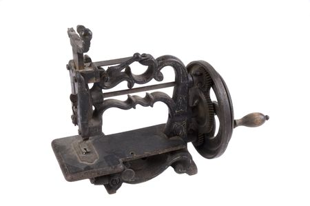 minature: Antique minature hand crank sewing machine isolated on white