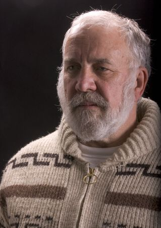 hemingway: older man looking like Ernest Hemingway isolated on black Stock Photo
