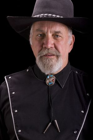 Handsome olld -boomer Cowboy dressed in black and looking like Buffalo Bill Cody Stock Photo