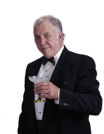older businessman enjoying a magarita in a tuxedo an isolated on white