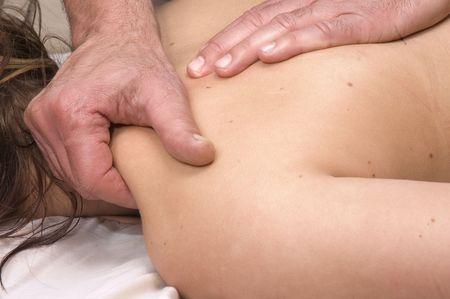 Woman having deep tissue massage Stock Photo