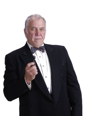 older businessman in a suit impersonating James Bond isolated on white with a gun photo