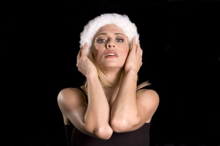 seductress: sexy blond female Santa adjusting hat