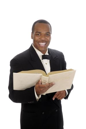preaching: young African American preacher giving sermon, quoting from the bible