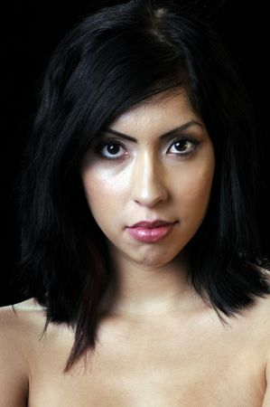 Beautiful young Hispanic brunette woman with red lipstick in closeup photo