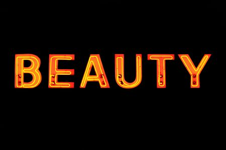 beauty shop: Neon sign with the word Beauty over black Stock Photo