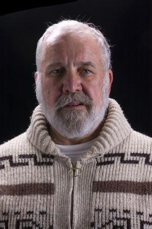 hemingway: bearded man in sweater modeling in Hemingway fashion