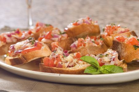Plate of fresh bruschetta with a sprig of mint photo