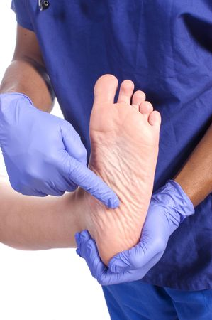 African american Doctor pointing to womans foot  Stock Photo
