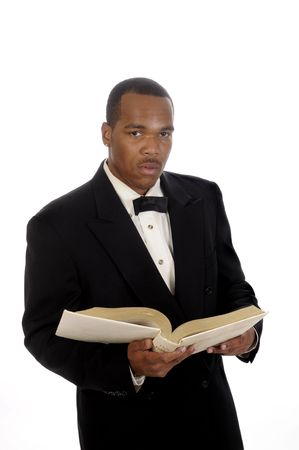 young African American preacher giving sermon, quoting from the bible
