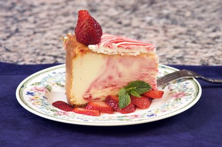 Plate of strawberry cheescake with fresh strawberries photo