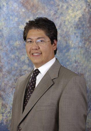 escrow: Attractive asian businessman