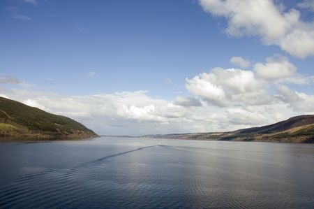 Loch Ness in Scotland with a wake from a boat which could be substituted by a monster! LOL! photo