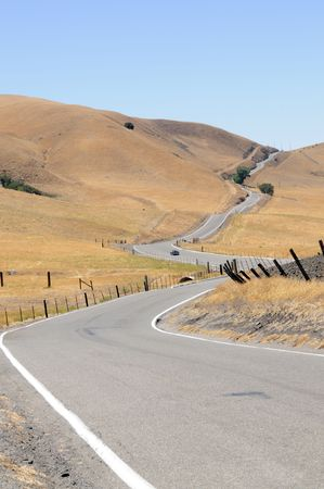 A sportster negotiating a  long winding country road in California photo