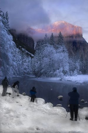 lined up: photographers lined up taking the Sunset on the granite peaks in Yosemite National Park along the Merced River banks