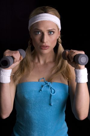 cardiovascular exercising: Middle-aged woman exercising with weights Stock Photo