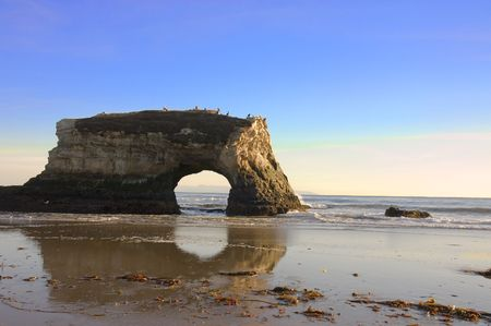 A natural archway created by the erosion of the sea photo