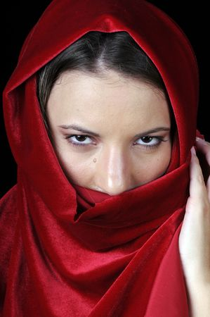 Beautiful young brunette woman in closeup with red shawl over face Stock Photo - 4205288