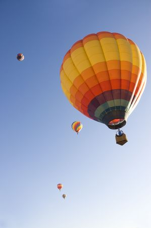 hot air: colorful balloons rising at dawn in the cold air at the Taos hot air balloon festival Stock Photo