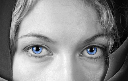 Monochrome of a beautiful woman with stunning blue eyes Stock fotó