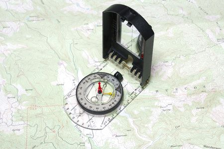 topographical: Closeup of compass and a topographical map showing detail
