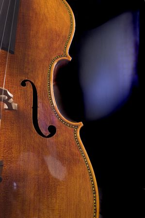 closeup of the scroll work on a beautiful cello Stock Photo