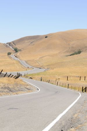 hot rod sports car negotiating a country road in California photo