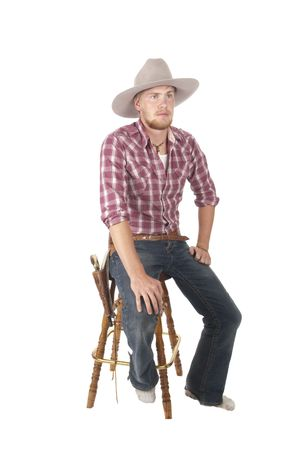 bootless young cowboy sitting on stool waiting to get new boots Stock Photo - 5025685
