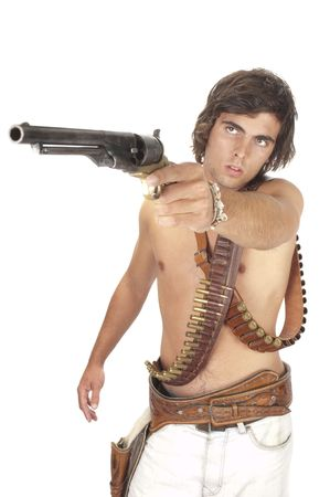 strapped: Young pistolero with ammunition belts strapped acroos his chest Rambo style and single action revolver pointed