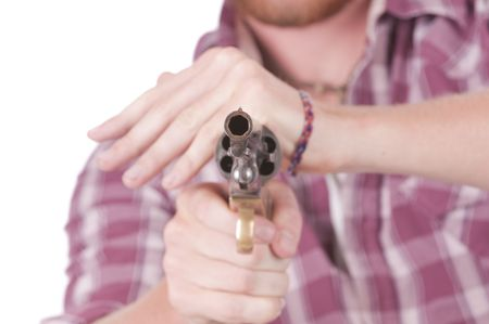 close range: looking down the muzzle of a revolver from close range with shallow DOF