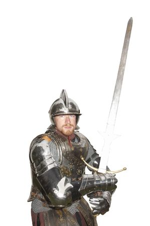 enactment: young man in armor with sword drawn during a Historical enactment, isolated