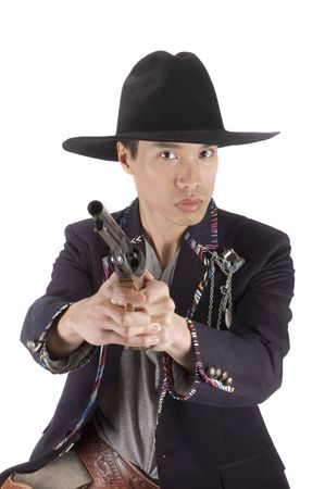 young asian cowboy with gun photo