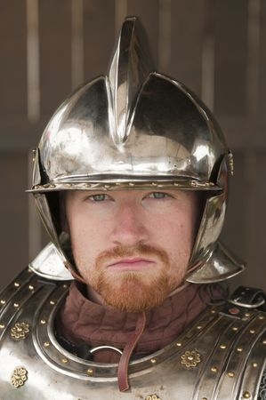 Young bearded Knight in shining armor photo
