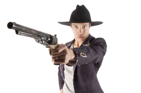 well dressed asian pointing gun over white background