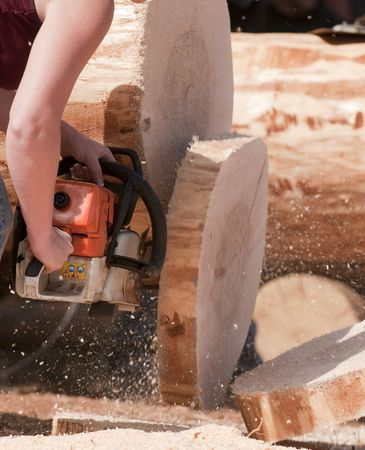 chainsaw cutting through log in lumberjack competition