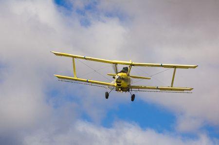 Crop dusting aircraft spraying fields photo