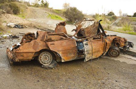 cul de sac: Burnt wreck of a car in a cul de sac