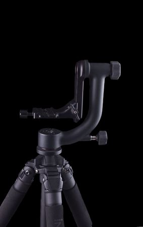 gimbal style tripod head on tripod in closeup clamshell lit over a black background