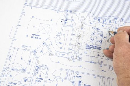 construction draftsman: Architect making changes to house plans
