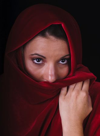 brown  eyed: closeup of a beautifully haunting image of a brown eyed woman in a red shawl