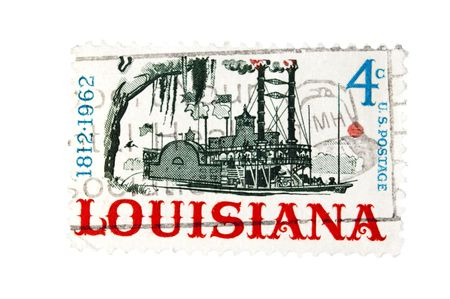 postmark: United States - CIRCA 1962: A 4 cent Vintage US postage stamp celebrating the 150th anniversary of the State of Louisiana, depicting a paddle steamboat, circa 1962 Stock Photo