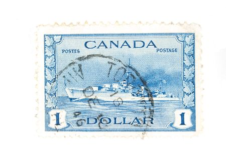 canada stamp: CANADA - Circa 1940 : A vintage Canadian postage stamp image of a navy destroyer value of 1 dollar, series circa 1940