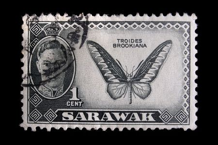 postage stamp: SARAWAK - CIRCA 1940: Depicting a butterfly and an inset of King George VI, with insciption