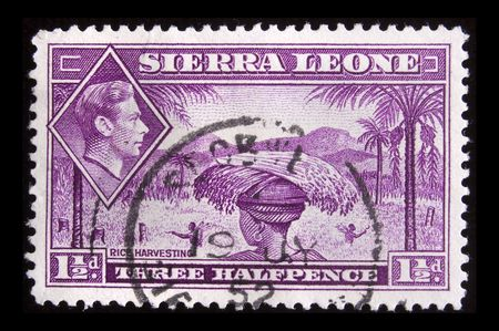 SIERRA LEONE - CIRCA 1940: Depicting indigenous person and an inset of King George VI, with insciption  Stock Photo - 6663691