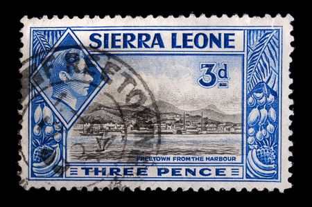 SIERRA LEONE - CIRCA 1940: Depicting city scene and an inset of King George VI, with insciption