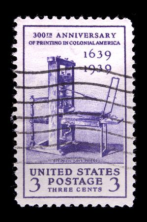 UNITED STATES - CIRCA 1939: depicting early printing press, inscripted 300th anniversary of Printing in Colonial America 1639-1939 , color purple, value 3 cents, circa 1939 photo