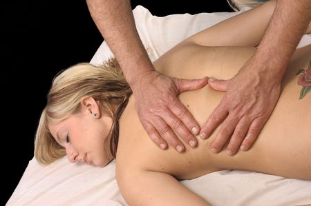 young woman getting Massage Therapy from a massuer photo