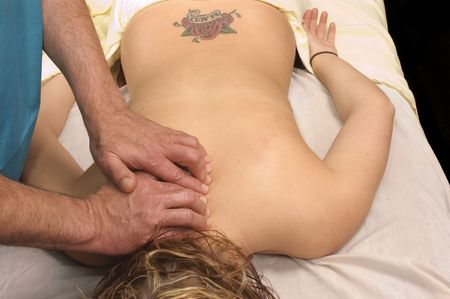young woman getting Massage Therepy from a massuer photo